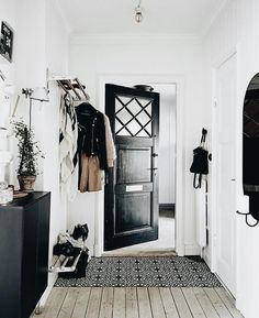 Asymmetrical - the contrasting blacks and whites really work well in this. And there's a good proportioned amount of shelves and accessories on either side