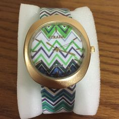 "Chevron watch The chevron trend is not going away and why would you want it to!  Look how cute this is!  Shades of blue & green with a touch of grey and white. Gold tone case. Measures approximately 1 1/2"" in diameter. New in box. Jewelry"