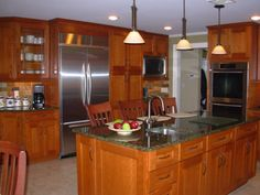 Bigger view of the kitchen I think would be great for Rochester resale...not our exact taste, and much darker than I'd like to go, but a very nice kitchen nonetheless