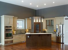 Off+white+cabinet+kitchen+with+gray+walls,+wood+island+and+glass+mosaic+tile+backsplash