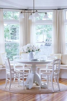 "Traditional Dining Room with Crate & barrel avalon 45"" white extension dining table, Chandelier, Exposed beam, Window seat"