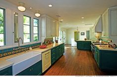 beautiful green lower cabinets, distressed white upper, yellow dishwasher and great backsplash