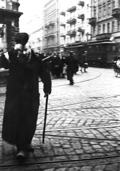 Warsaw Ghetto, Poland, An elderly Jew marching in the street.