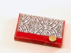Upcycle an old cassette tape case into a gift card holder using paper and Mod Podge.