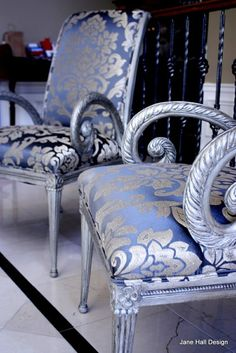 Repurposed Carved Wood Accent With Painted And Distressed Silver Finish Chairs.  The Silver And Blue Fabric Is Totally Gorgeous!