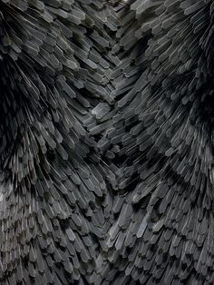 Iris Van Herpen (Dutch, born 1984) . Dress(detail), spring/summer 2009, Prêt–à–Porter. Machine–sewn black synthetic knit with machine– and hand–sewn hand–cut black plastic fringe, padded and hand–finished hem. Photo © Nicholas Alan Cope. #ManusxMachina #CostumeInstitute