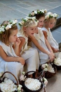 Flowers girls need flower tiaras and  big ribbon bows