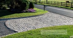 Can't afford to pave the whole driveway, just do the entrance and the rest in pea gravel