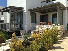 A luxury holiday villa in Lolantonis on Paros island The villa is 115 sq. meters and has been built on 2 floors, the surrounding well-kept garden is 400 sqm.) The villa faces south, very closed to Lolantonis beach. Paros Island, Luxury Holidays, 2nd Floor, Greek Islands, Villas, Floors, Greece, Faces, Building