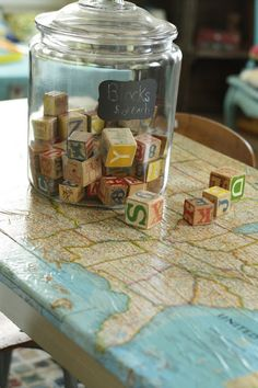 Awesome table for the boys in their playroom. Maybe modge podge maps to the tops of their desks?? Primitive & Proper