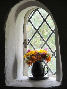 Flowers on a window sill at Cotehele, Cornwall. Cozy Cottage, Cottage Style, Window View, Window Art, Through The Window, English Style, Window Boxes, Shabby Vintage, Doorway