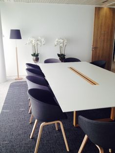 A meeting room with galant conference table in ash veneer for Table design latex