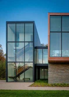 Modern residential architecture with floor to ceiling glass windows bringing in natural light