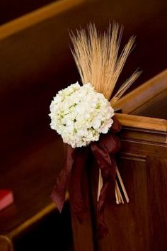 At the risk of overdoing wheat - I like this - white hydrangea, a wheat spray and a satin ribbon, colour of your choice for a pew bow.