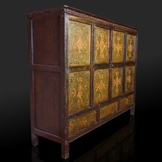 Only state officers and the most important families had furniture in their homes, especially trunks and cupboards used for storage. This cupboard made of Himalayan conifer, with central double doors, retains the charm of Tibet. The magic of the original polychrome decoration with floral and geometric motifs makes it a masterpiece. The front is divided into eight panels of equal size: the four in the centre are opening doors. Size: 135 x 42 x 108 (H) cm.