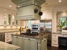 With its stone island, state-of-the-art appliances and professional-grade hood, this custom-designed kitchen is a gourmet chef's dream.