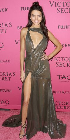 Kendall Jenner owned the 2015 Victoria's Secret Fashion Show and the after-party—all in one night. After her VS Angel debut, she changed into a sheer shimmery olive green Versace gown with a dangerously high slit, complete with strappy metallic sandals
