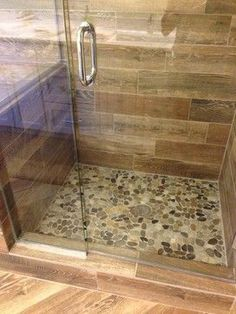 shower remodel natural look with mosaic flat rock pebbles and woodlooking tile