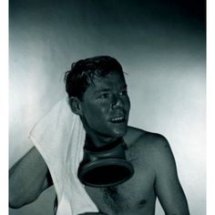 Studio shot of man with gas mask drying hair with towel Canvas Art - (24 x 36)