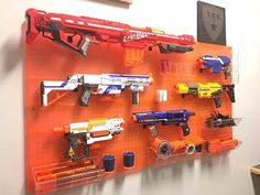 How to build a Tactical Nerf Gun Wall You are in the right place about Nerf Gun Storage bag Here we Nerf Gun Storage, Toy Storage, Storage Cart, Pistola Nerf, Teen Boy Rooms, Nerf Mod, Wall Racks, Baby Gear, Game Room