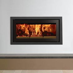 Fireplace Products Presents - The Riva Studio 2 Wood Cassette. The Riva Studio collection consists of 3 different sized cassettes offering outputs up to 11kW. These modern landscape cassettes are available with a wide range of frames to suit your décor, and compliment the beautiful dancing flames achieved when burning wood. Available for sale from Fireplace Products, don't forget to mention you found us on Pintrest to receive an extra discount!