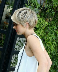 Pixie.. with long side bangs.. perfect for thick hair