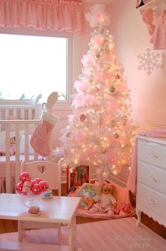 The way to do a pink tree. White tree + Tulle balls stuffed EVERYWHERE = estrogen christmas overload. For Sophia's room if I can find a mini white tree. Pink Christmas Tree, Shabby Chic Christmas, Noel Christmas, Vintage Christmas, Christmas Decorations, Holiday Decor, Christmas Ideas, Christmas Bedroom, Xmas Tree