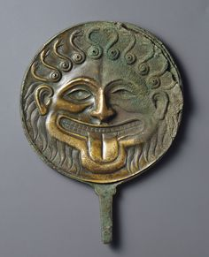 Hand Mirror Decorated with the Head of Medusa; Unknown; South Italy; 500 - 480 B.C.; Bronze; 20.2 × 15 × 2 cm (7 15/16 × 5 7/8 × 13/16 in.); 96.AC.109; Gift of Barbara and Lawrence Fleischman; J. Paul Getty Museum, Los Angeles, California