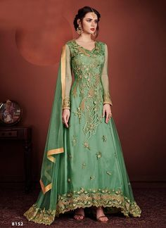 Green Colour Net Fabric Attractive Salwar Kameez in Anarkali Style The lovely Embroidery,Stone work are substantial attribute of this attire.Wear this salwar suit on any Indian festival or wedding and grace the occasion with your presence Anarkali Tops, Silk Anarkali Suits, Long Anarkali, Anarkali Dress, Silk Dupatta, Salwar Suits, Net Gowns, Indian Clothes Online, Designer Anarkali