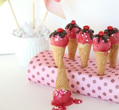 Cake Pops- Ice Cream Cone style. Cute way to hold them.