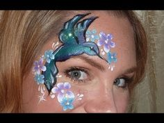 humming bird design tutorial by lisa joy young *One of my favorite face painters, Lisa Joy Young, demos a butterfly that is great as cheek art, eye design, arm tatoo, etc. Only use professional face paints, never acrylics (not meant for skin!)