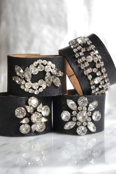 A soft and supple leather and rhinestone cuff bracelet. The leather is part of an old belt that has aged to butter softness and wraps the wrist like a hug. I have adorned it with what was a vintage rhinestone brooch/pin. This rhinestone jewelry piece is sewn on, not glued, so as