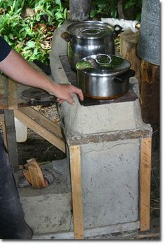 cool pic of a rocket stove.  Link does NOT take you to a how to, unfortunately