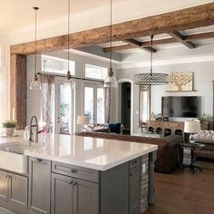 Exposed wood beams framing through way from kitchen to living room.beautiful warm touch accentuating both rooms! Farmhouse Kitchen Decor, Home Decor Kitchen, Home Kitchens, Kitchen Design, Modern Farmhouse Kitchens, Kitchen Ideas, Farmhouse Homes, Warm Kitchen, Modern Farmhouse Decor