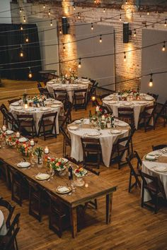 one long banquet style table in center with round tables surrounding it also like the neutral tablecloths and runners