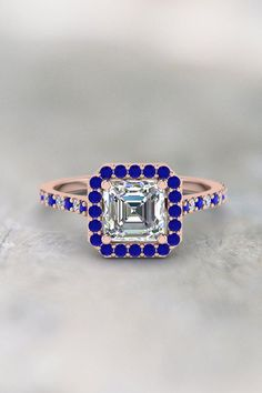 Asscher Halo Diamond  Engagement Rings with Blue Sapphire in 14K Rose Gold exclusively styled by Fascinating Diamonds