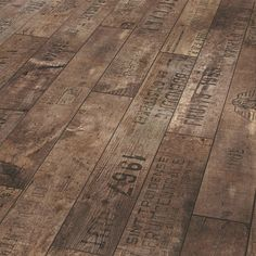 This wine box crate inspired floor line by European based Parador is truly inspiring! The Wine and Fruits laminate floor collection is a nod to the repurposed looks we've noticed. The interesting stampings from different vintage crate samplings are an incredible way to add a unique texture to any room.