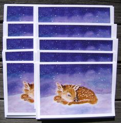 Here is a fawn lying in the snow on a wintery day!  This is one of Annamarie's favorite artworks, and this would make a perfect non-denominational holiday card.  The inside of the card reads:  May love and joy fill your heart this holiday season