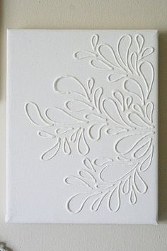 Elmers glue on canvas. Then paint the whole thing one color. Beautiful! (would be cute with animals in a nursery on little canvases - matching dif colors in the nursery)