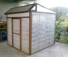 Heres the idea build towers for rain barrels at the ends of beds how to build a diy greenhouse with plastic water bottles step by step tutorial instructions diy water bottle green house instructions here ana white solutioingenieria Gallery