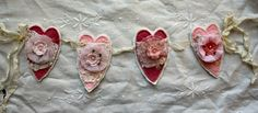 Shabby Valentine Heart Garland Tutorial - I think these would look fabulous quilted with little raggy edges too  ************************************************   PaperWhimsy - #shabby #chic #Valentines #valentine #heart #flowers #garland #banner #crafts #paper #fabric #papercrafts #diy #decoration #holiday - tå√