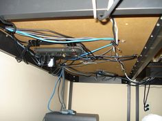 Organizing cables under the desk.