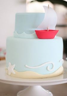 tiered cake with boat.  Add fish below to bottom tier.