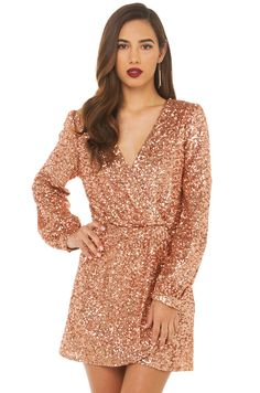 Be memorable this holiday season. AKIRA's Wild About Tonight Sequin Dress in Rose Gold features a front deep v neckline, elasticized waist with gathered wrap detail, and long sleeves with button closure cuffs. Pair with pumps & statement earrings. Dresses For Teens, Trendy Dresses, Sexy Dresses, Cute Dresses, Evening Dresses, Short Dresses, Prom Dresses, Dresses With Sleeves, Dress Prom