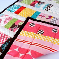 """With one """"It's a Hoot"""" charm pack, I made this sweet little quilt for a sweet little baby."""