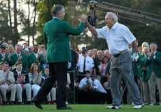 Augusta National Golf Club chairman William Porter Payne (L) high fives honorary starter Arnold Palmer after his tee shot on the first hole during the start of first round of the 2012 Masters Tournament at Augusta National Golf Club on April 5, 2012 in Augusta, Georgia. (Photo by Jamie Squire/Getty Images)