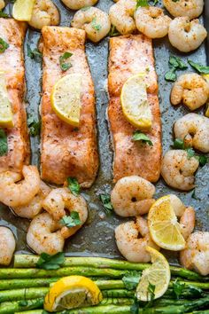 Baked one pan meal with salmon, shrimp and asparagus. - Replace Butter with Ghee to make it Whole30!