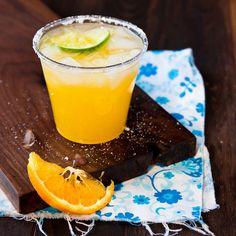 Orange Margarita 6 oz margarita mix or the homemade, 6 oz fresh squeezed orange juice, 6 oz tequila, 4 oz orange liqueur (Paula's orange), sugar for rimming glass