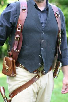 Steampunk shoulder holster by DocStonesTinkering on Etsy. Okay, I know it's steampunk, but I'm thinking of my dad and his belt loaded with tool holsters, and his pants having to be held up by suspenders. This would solve that! Leather Armor, Leather Belt Bag, Leather Holster, Leather Tooling, Gun Holster, Holsters, Style Steampunk, Steampunk Fashion, Steampunk Belt