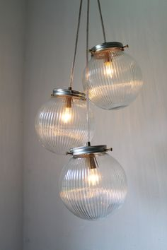 Sparkling Cluster Chandelier Lighting Fixture - 3 Round Ribbed Glass Holophane Globes  - Industrial UpCycled Swag Pendant BootsNGus Design. $140.00, via Etsy.